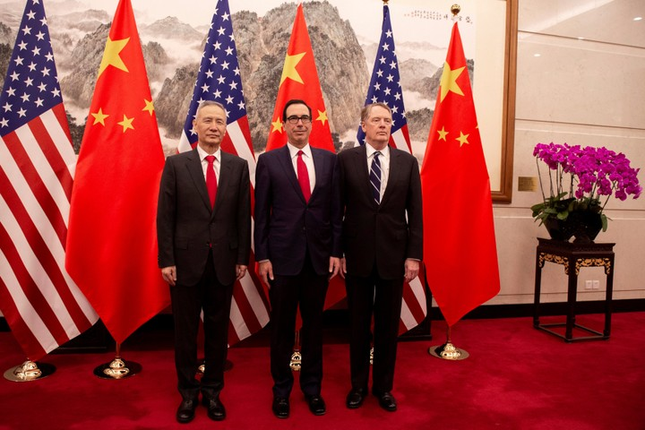 China's Vice Premier Liu He (L) pose for a photo with US Treasury Secretary Steven Mnuchin (C) and US Trade Representative Robert Lighthizer (R) at Diaoyutai State Guesthouse in Beijing on March 29, 2019.