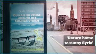 Danish far-right group puts up posters telling refugees to 'go back to sunny Syria'