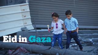 Palestinian kids celebrate Eid al-Fitr amid destruction