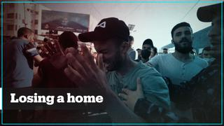 Palestinians in Gaza mourn the loss of their homes
