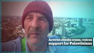 69-year-old British activist scales crane to highlight plight of Palestinians