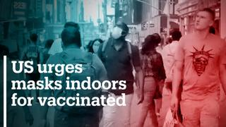 US federal health agency urges masks indoors for vaccinated