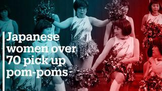 Elderly Japanese women pick up pom-poms
