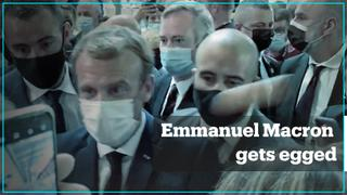 French President Emmanuel Macron gets egged on his way to Lyon