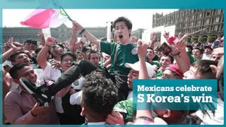 Mexico fans celebrate South Korea's win against Germany in the World Cup