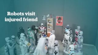 Robots visit injured robot friend after fall