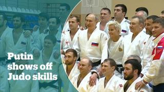 Putin demonstrates black belt judo skills