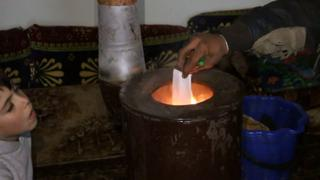 The War in Syria: Residents find ways to keep warm in winter