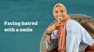 Muslim American faces anti-Muslim protest with a smile