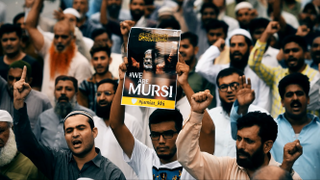 Why was Morsi's death downplayed?