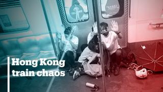 Police in Hong Kong beat up protesters on train