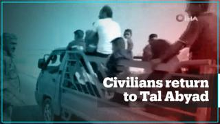 Civilians return to recently liberated Tal Abyad