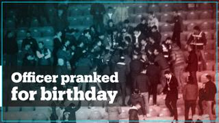 Football fans fake riot for birthday surprise