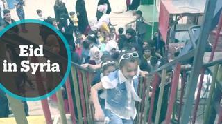 Aid workers help Syrian orphans celebrate Eid al Fitr