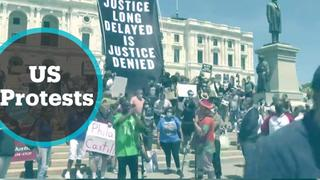 Thousands of protesters defy curfews across US