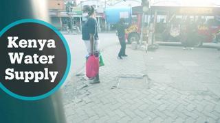 Volunteer in Kenya supplies water to pedestrians