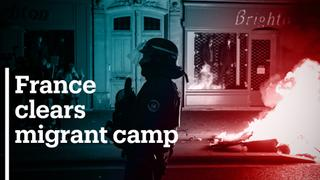 Violent protests in Paris after police clear migrant camp