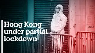 Hong Kong officials put 10,000 people under lockdown