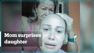 Mom shaves off hair in solidarity with daughter who has cancer