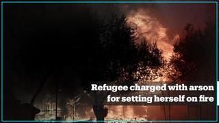 Refugee who set herself on fire in Greece's Lesvos is charged with arson