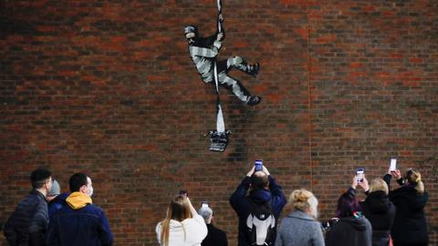 Banksy takes credit for prison artwork