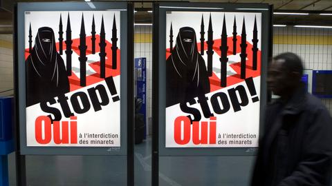 Switzerland bans burqa and niqab, hurting its Muslim minority