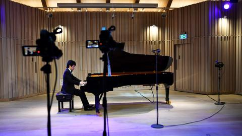 Pianists play for prestigious prize for audience of one, a camera operator