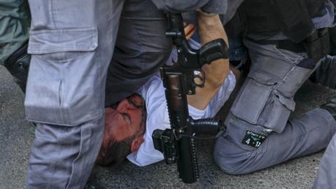 Israeli police beat lawmaker at eviction protest in east Jerusalem