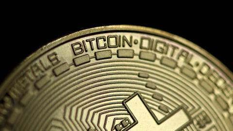 Bitcoin swings past $62,000 to hit record high