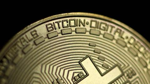 Bitcoin price tops $60,000, first time in six months