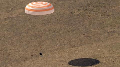 Astronauts return to Earth from International Space Station