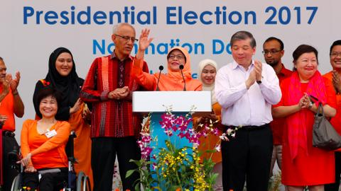 Singapore names first woman president amid concerns over election process