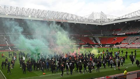 Match postponed as Man Utd fans invade Old Trafford in anti-Glazer protest