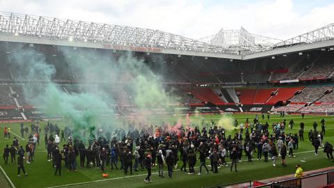 Match postponed as Man Utd fans invade Old Trafford in anti-Glazer protest