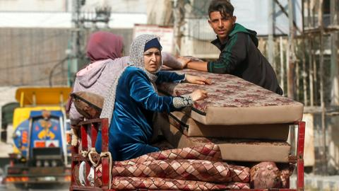 Palestinians in Gaza flee homes as over 100 dead in Israeli attacks