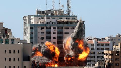 Israel bombs tower housing foreign media, kills 10 members of Gaza family