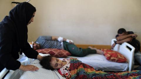 Egypt accepts Gaza's wounded, urges UN to solve crisis