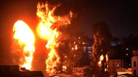 Israel launches heavy air strikes on Gaza as death toll nears 200