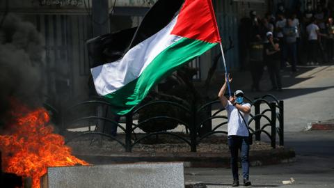 Israeli police open fire on Palestinian protesters in occupied West Bank