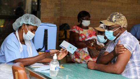 WHO: 9 in 10 African countries to miss virus vaccine goal – latest updates