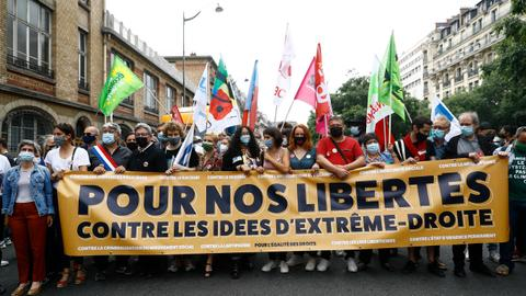 Tens of thousands take to streets in France to protest against far-right