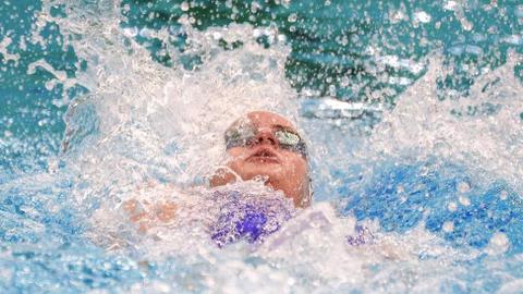 Australia's McKeown breaks 100-metre backstroke world record