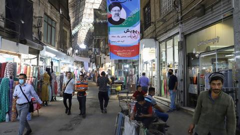 Iran presidential race narrows as more candidates drop out last minute
