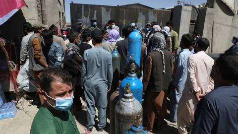Afghanistan running out of oxygen as Covid surge worsens – latest updates