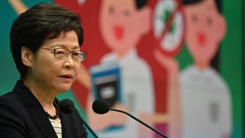 Hong Kong leader Lam lashes out at criticism over Apple Daily raid