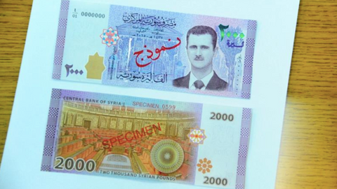 Syrians boycott new currency featuring Assad's face