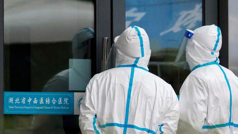 China rejects WHO audit of labs in second phase of Covid origin probe