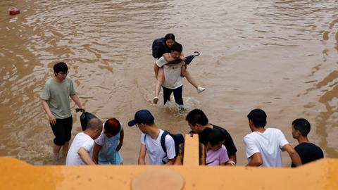 Thousands flee fresh floods in China as typhoon approaches country's east