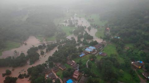 Dozens killed in landslides in western India, floods trap more