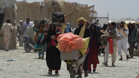 Afghan families flee their homes as fighting intensifies in Kandahar